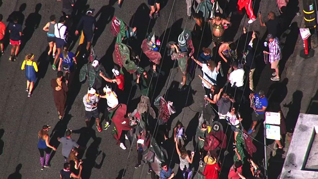 Runners are seen taking part in the 106th annual Bay to Breakers race in San Francisco on Sunday, May 21, 2017.KGO-TV
