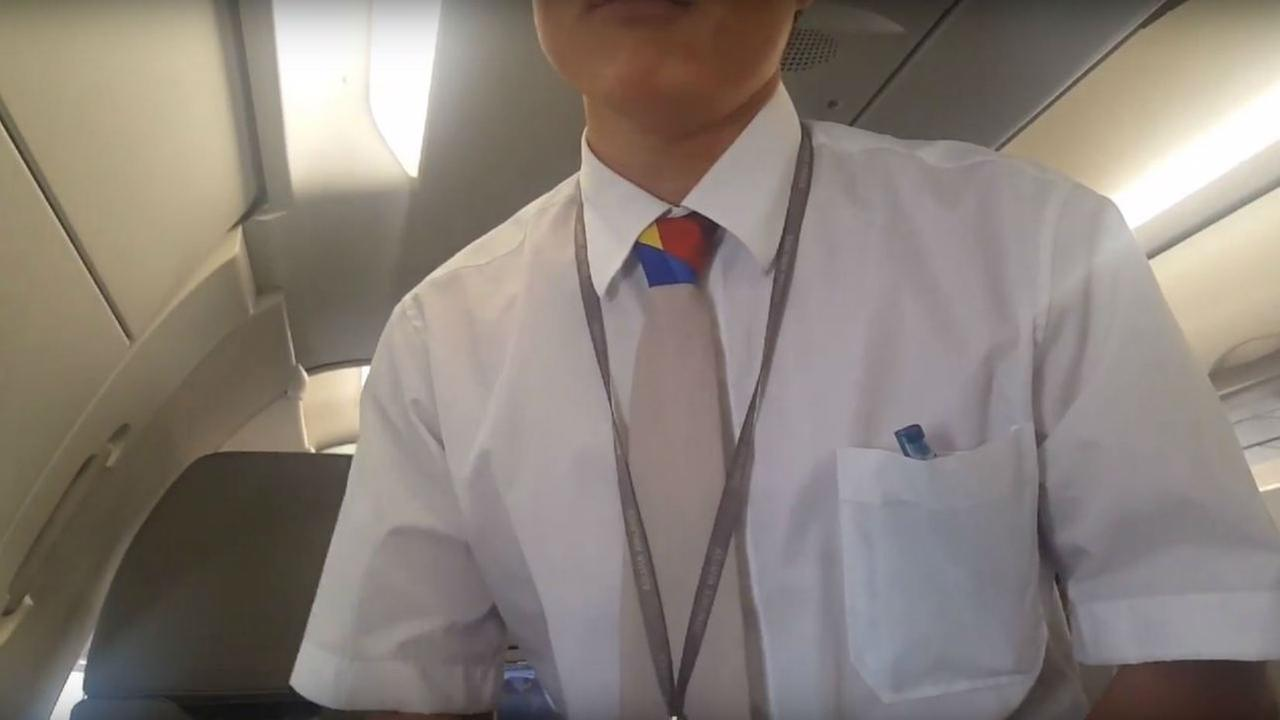 An Asiana Airlines employee is seen speaking to a passenger on Sunday, May 21, 2017.