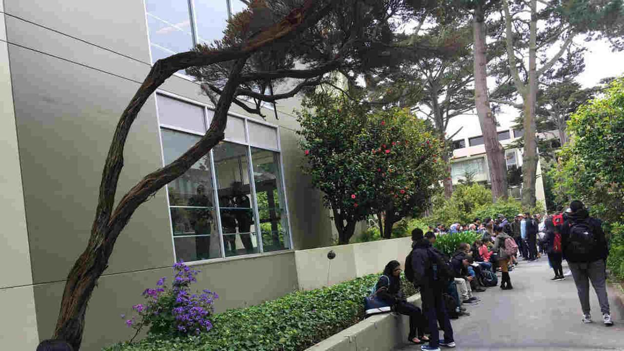 Students are seen evacuating a building at San Francisco State University after a bomb threat on Wednesday, May 24, 2017.
