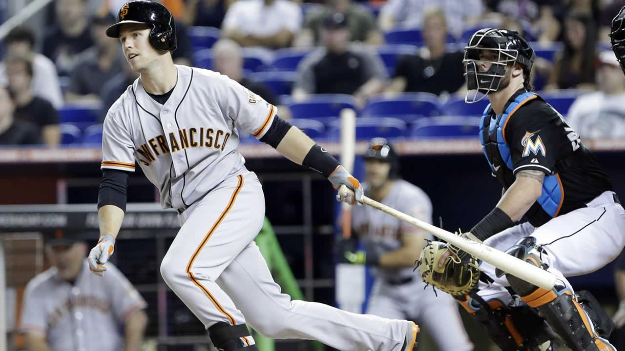 San Francisco Giants Buster Posey bats during the first inning of a baseball game against the Miami Marlins, Saturday, July 19, 2014 in Miami. (AP Photo/Wilfredo Lee)