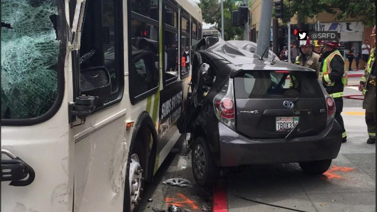 A Prius is seen crashed into the side of a bus in San Rafael, Calif. on Wednesday, May 24, 2017.