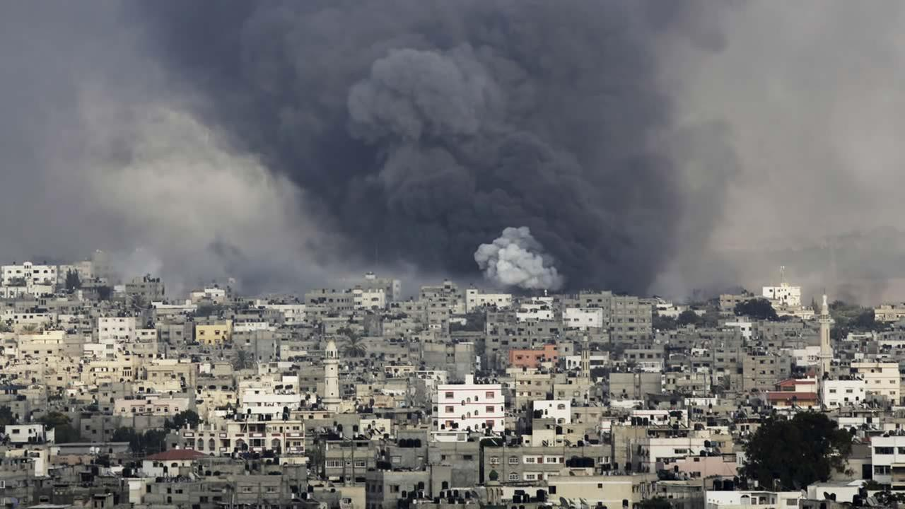 Smoke rises from explosions caused by an Israeli missile strike in the Shijaiyah neighborhood in Gaza City, northern Gaza Strip, Sunday, July 20, 2014. (AP Photo/Adel Hana)