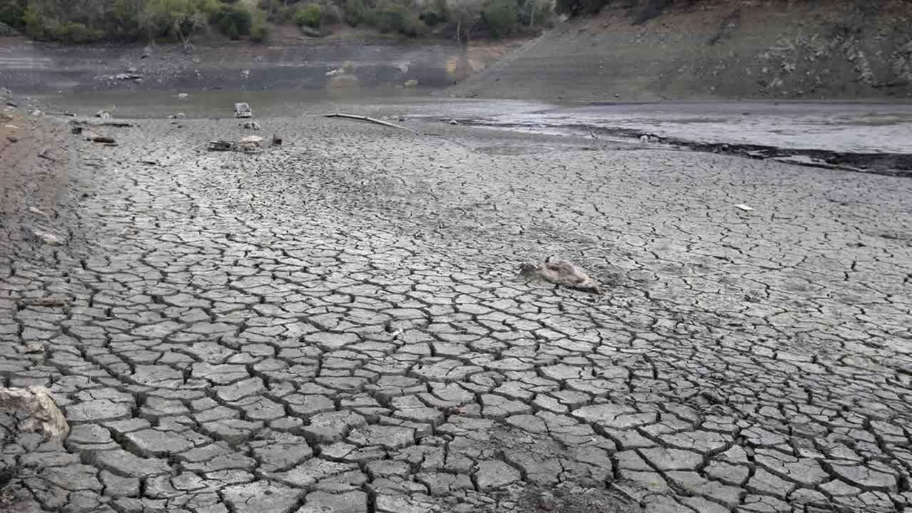 The cracked-dry bed of the Almaden Reservoir is seen on Friday, Feb. 7, 2014, in San Jose, Calif. (AP Photo/Marcio Jose Sanchez)