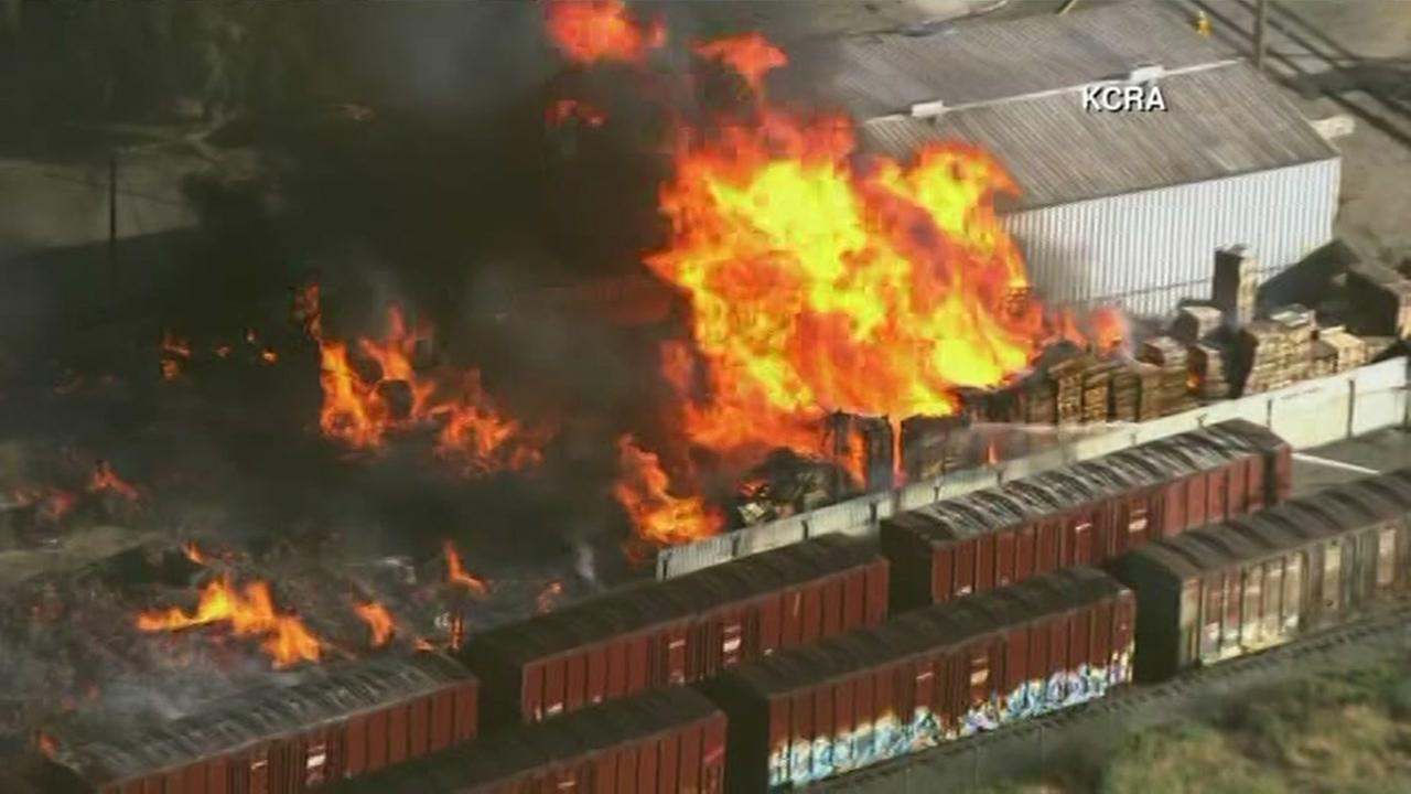 A large pallet fire rages through Stockton, Calif. on Thursday, May 25, 2017.