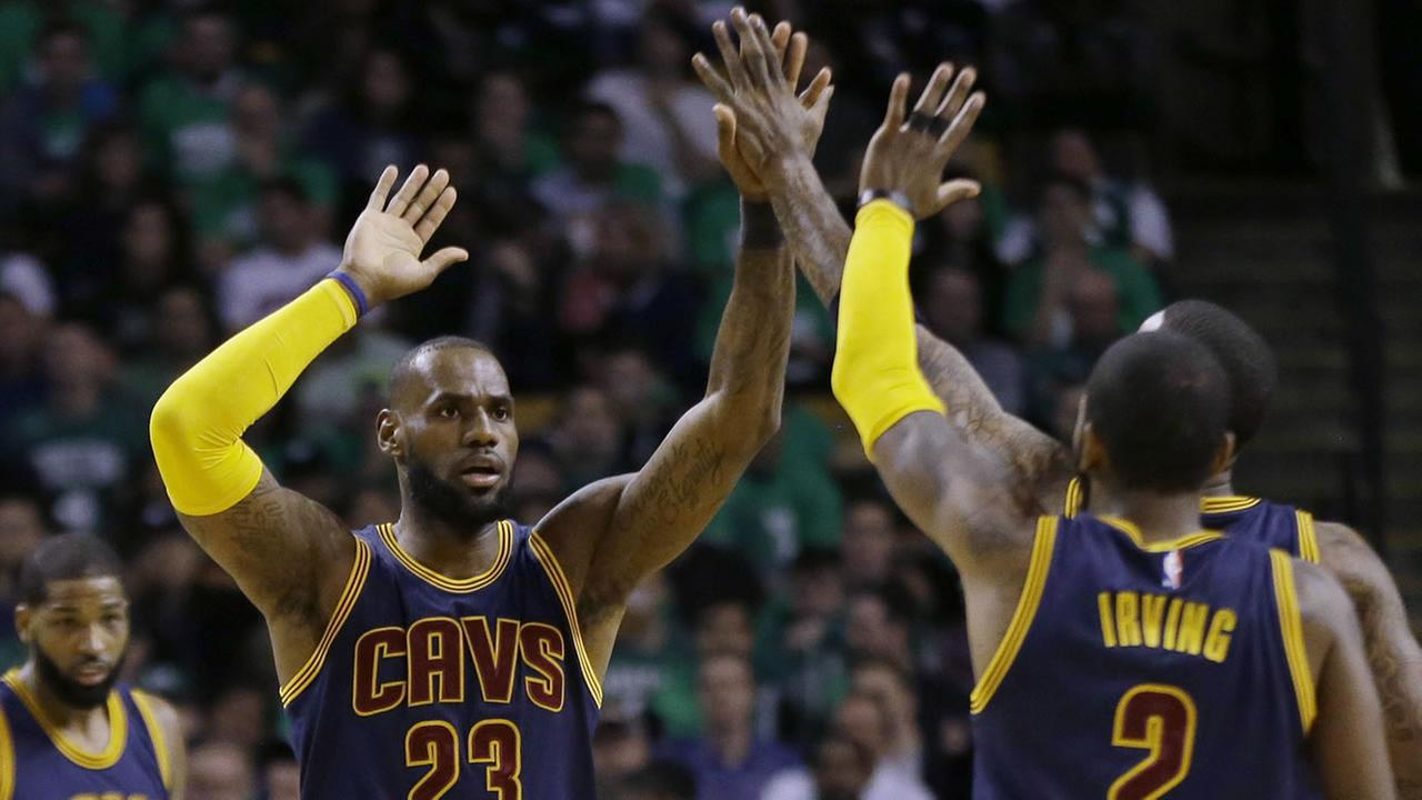 LeBron James and Kyrie Irving of the Cleveland Cavaliers high-five during Game 4 of the NBA Western Conference Finals on Thursday, May 25, 2017.