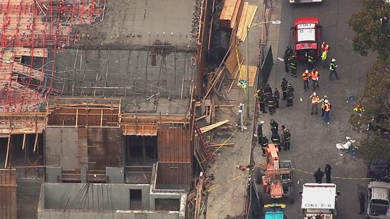Workers dangling from cables after scaffolding collapses