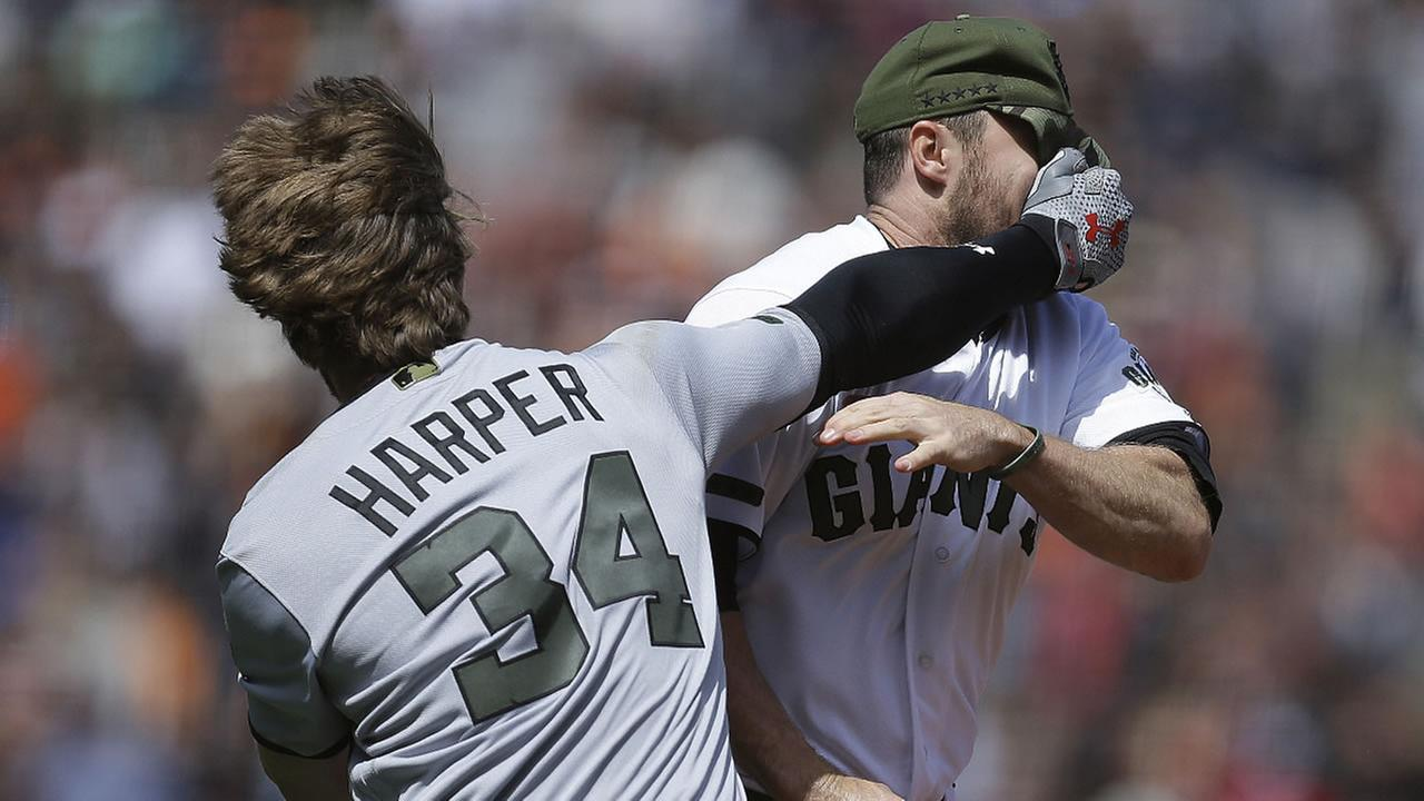 Nationals Bryce Harper hits Giants Hunter Strickland in the face after being hit with a pitch in the eighth inning of a baseball game Monday, May 29, 2017 in San Francisco.
