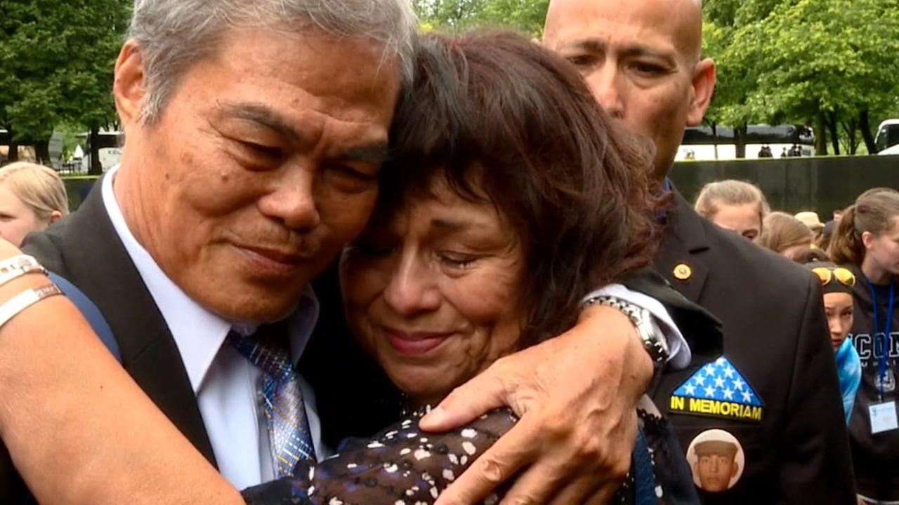 Family members who lost loved ones in the Vietnam War embrace in Washington D.C., on May 29, 2017.