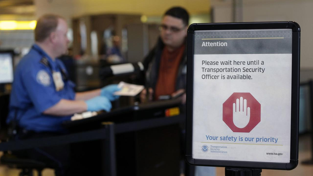 A sign greets travelers in front of a TSA checkpoint at Baltimore-Washington International Thurgood Marshall Airport in Linthicum, Md., March, 1, 2013 (AP Photo/Patrick Semansky)