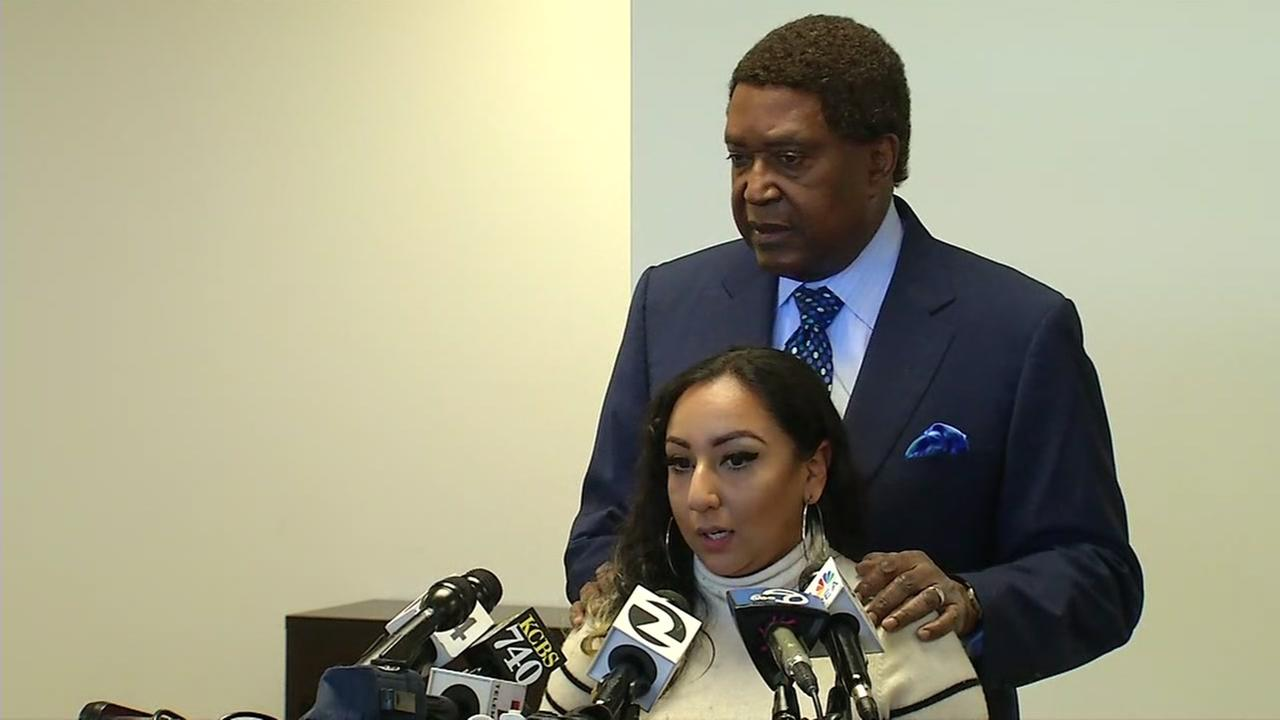 Jasmine stands with her attorney, John Burris, during a press conference on Wednesday, May 31, 2017.