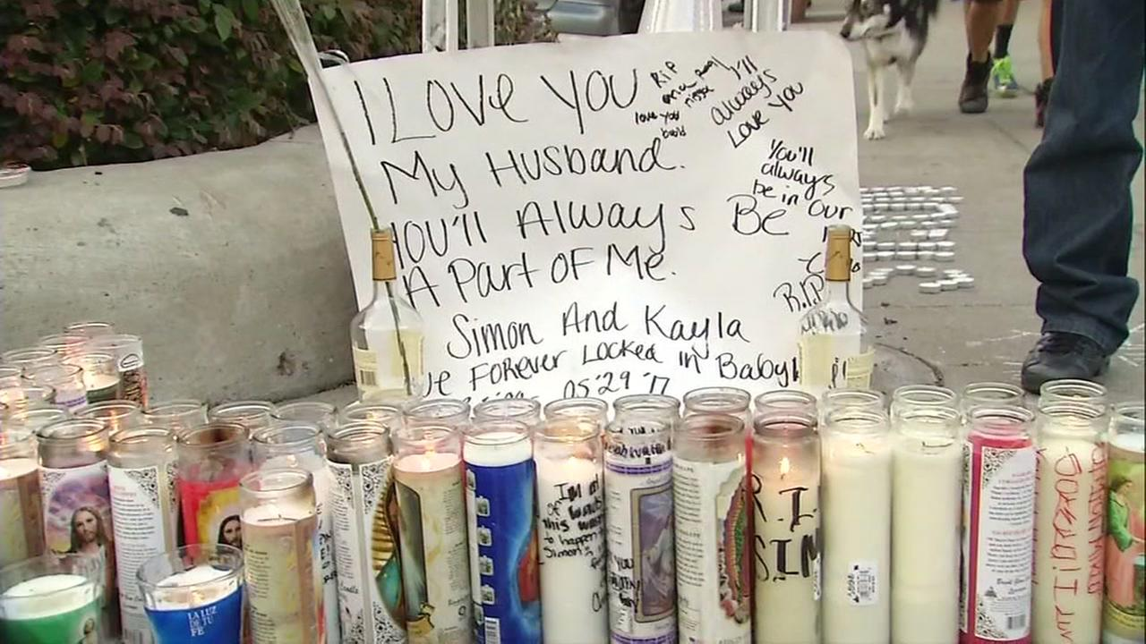 Candles appear at a vigil for two car crash victims in Alameda, Calif. on May 31, 2017.