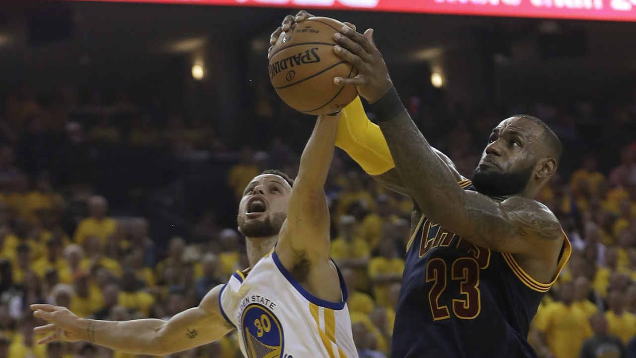 Cleveland Cavaliers forward LeBron James (23) grabs a rebound against Golden State Warriors guard Stephen Curry (30) during the first half of Game 1 of basketballs NBA Finals.AP Photo/Marcio Jose Sanchez