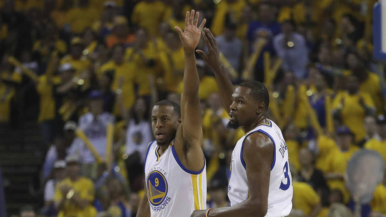 Golden State Warriors forward Andre Iguodala (9) and forward Kevin Durant (35) react after scoring against the Cleveland Cavaliers during the first half of Game 1 of the NBA FinalsAP Photo/Marcio Jose Sanchez
