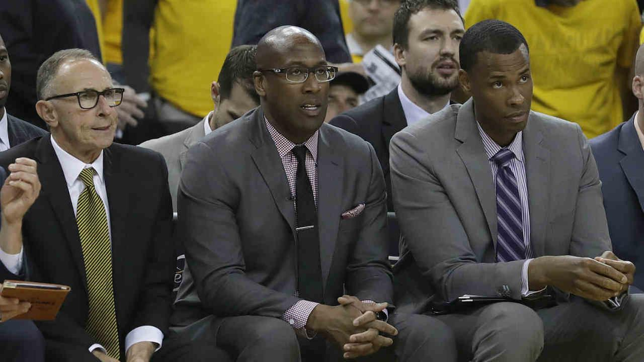 Golden State Warriors interim head coach Mike Brown, center, sits between assistant coaches Ron Adams, left, and Jarron Collins during the first half of Game 1 of the NBA Finals.AP Photo/Marcio Jose Sanchez