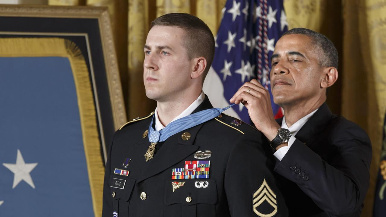 President Barack Obama bestows the Medal of Honor, the nations highest decoration for battlefield valor, to Ryan M. Pitts, 28, of Nashua, NH.
