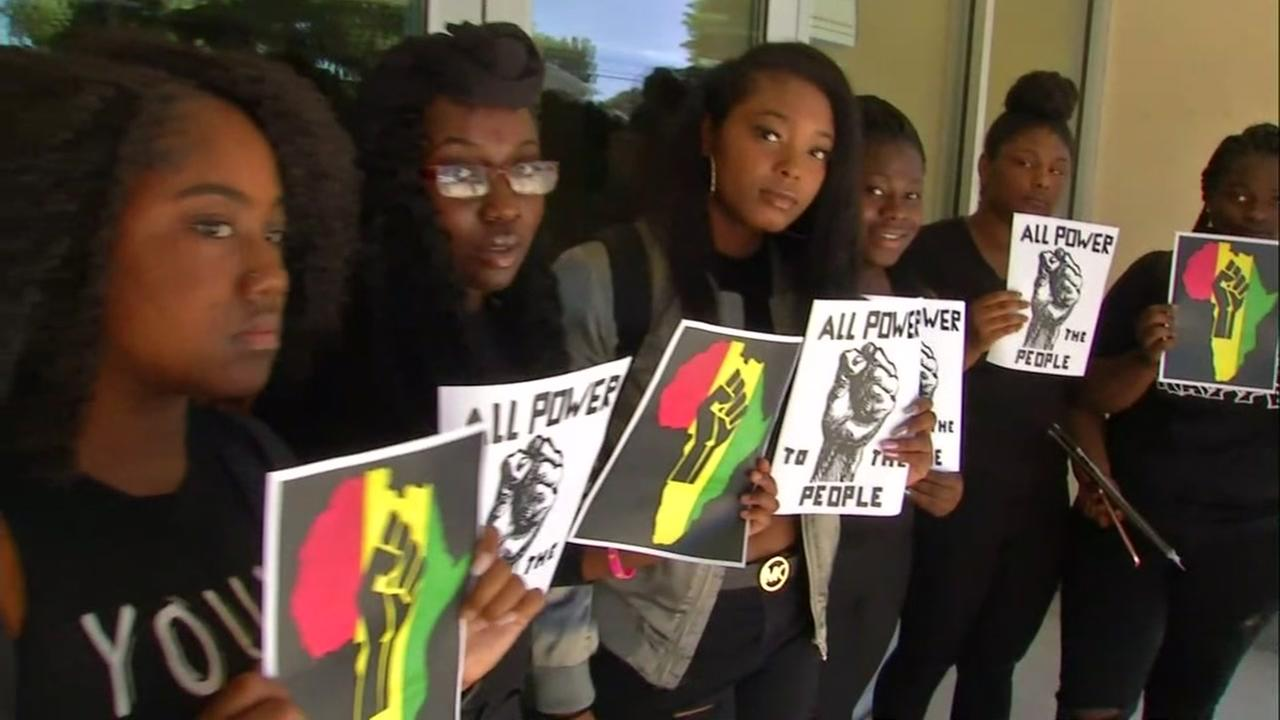 Students at Castro Valley High School stand in solidarity after racist graffiti was found at their campus on June 2, 2017.