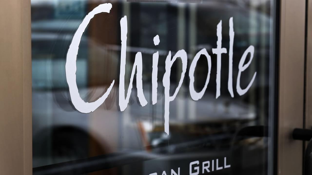 This file photo shows the door at a Chipotle Mexican Grill in Robinson Township, Pa.