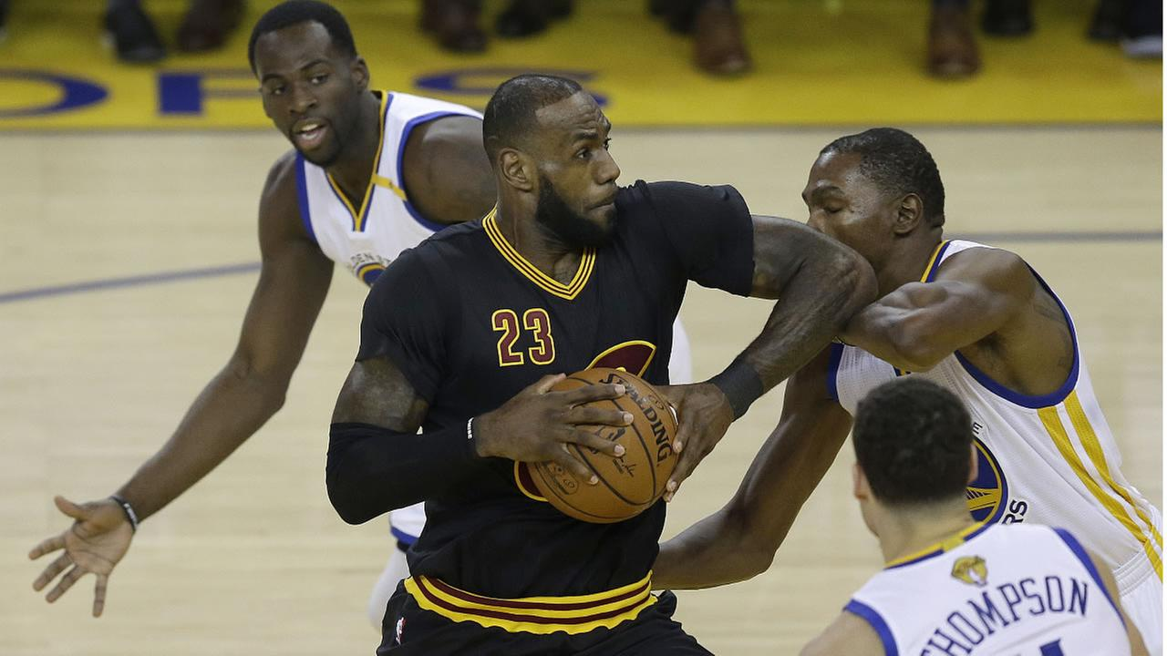 Cavaliers forward LeBron James shoots between Warriors forward Draymond Green during the first half of Game 2 of basketballs NBA Finals in Oakland, Calif., June 4, 2017. (AP Photo