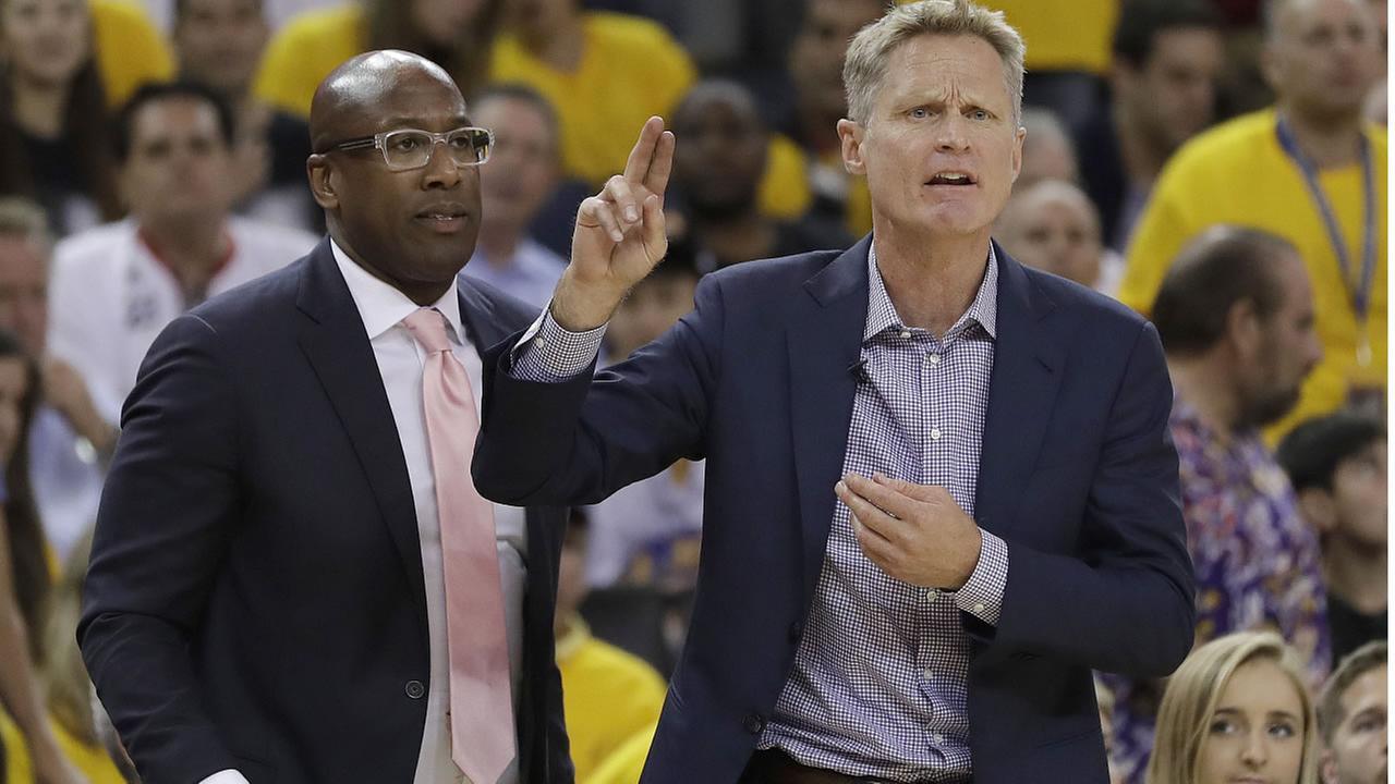 Warriors coach Steve Kerr gestures during Game 2 of basketballs NBA Finals against the Cleveland Cavaliers in Oakland, Calif., Sunday, June 4, 2017. (AP Photo/Marcio Jose Sanchez)