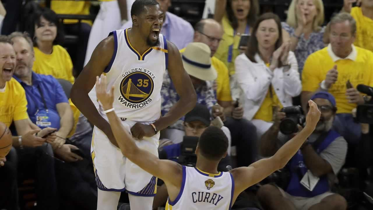 The Warriors Kevin Durant celebrates with Stephen Curry during Game 2 of the NBA Finals against the Cavaliers in Oakland, Calif., Sunday, June 4, 2017.