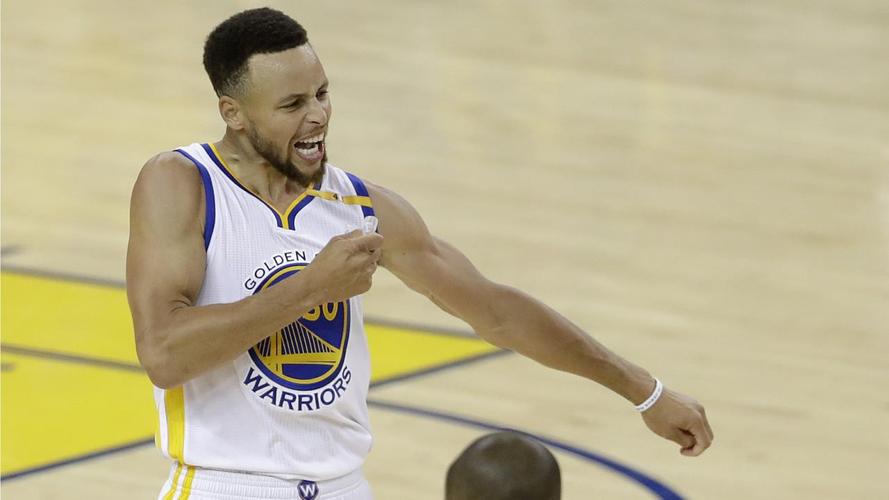 Warriors Stephen Curry reacts after scoring against the Cavaliers during Game 2 of basketballs NBA Finals in Oakland, Calif., Sunday, June 4, 2017. (AP Photo/Marcio Jose Sanchez)