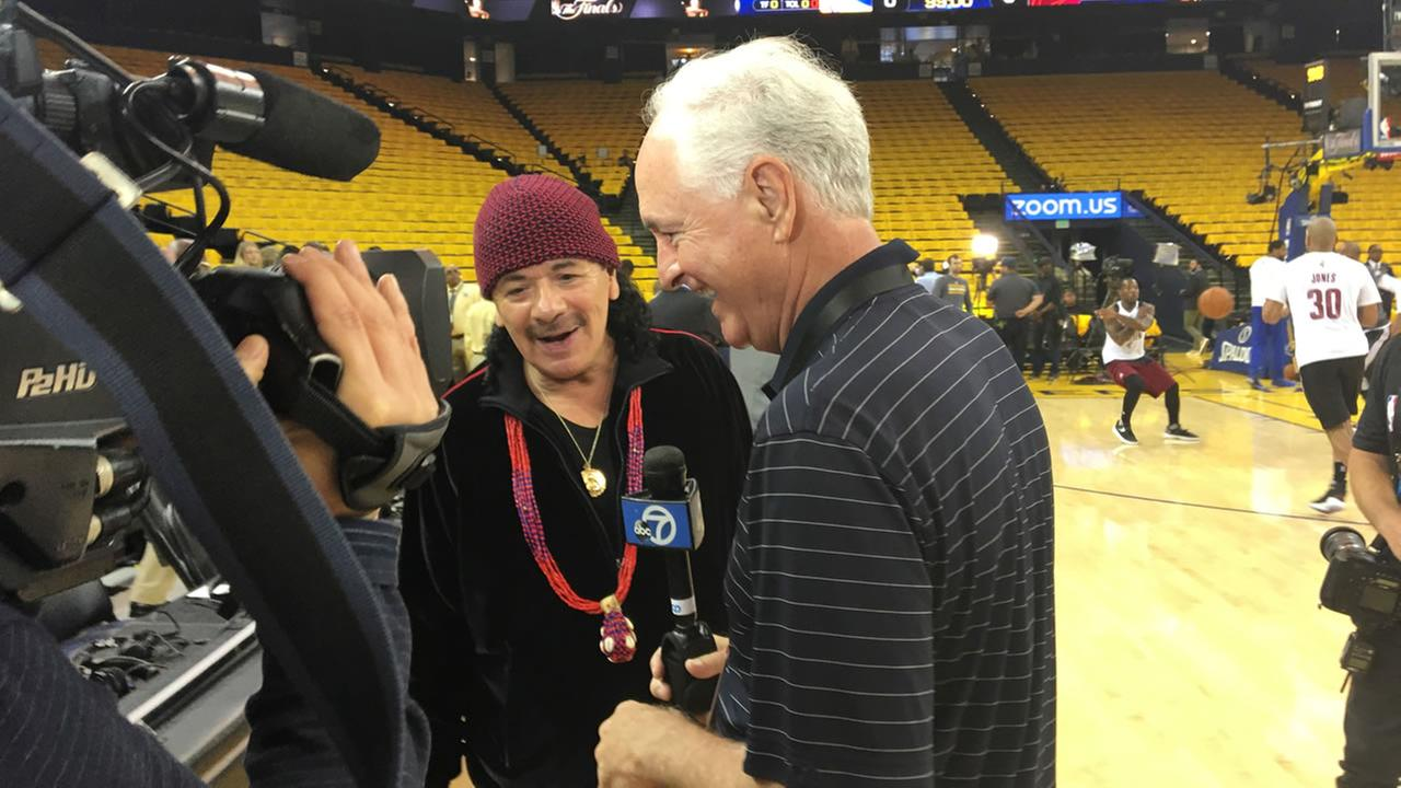 Mike Shumann interviews Carlos Santana before game 2 of the NBA Finals in Oakland, Calif. on Sunday, June 4, 2017.KGO-TV