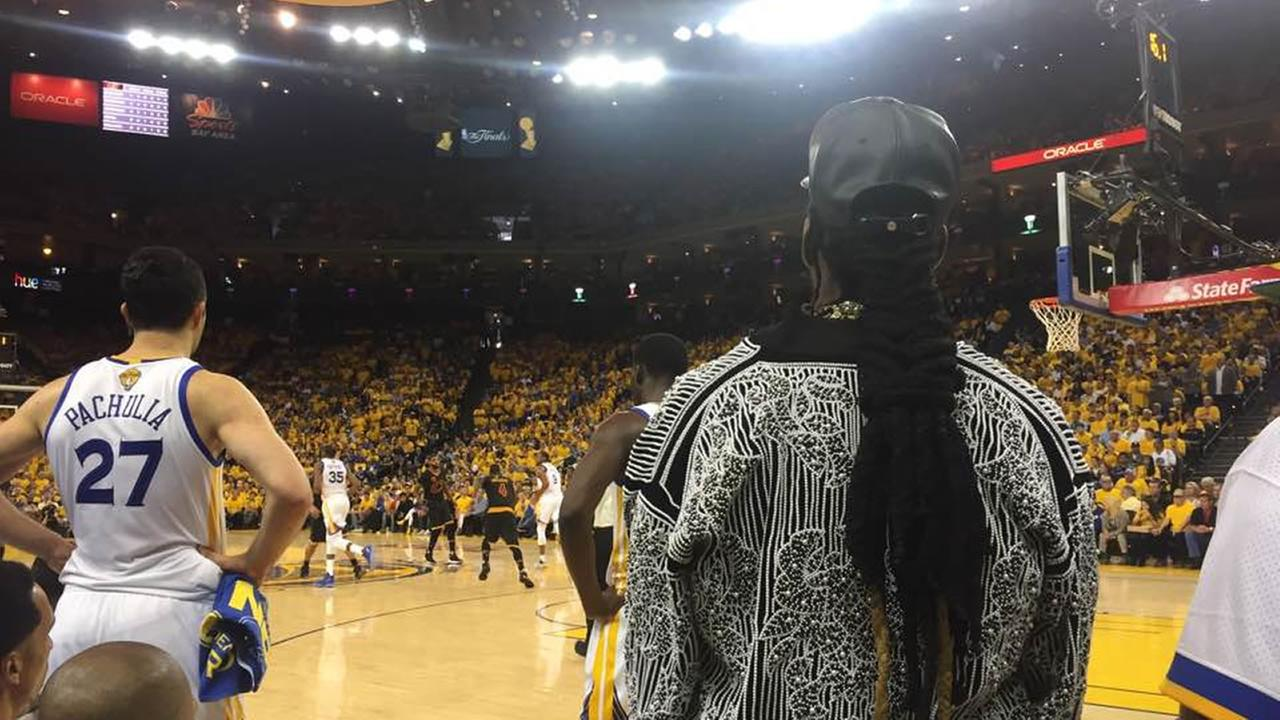 Rapper 2 Chainz watches game 2 of the 2017 NBA Finals in Oakland, Calif. on Sunday, June 4, 2017.