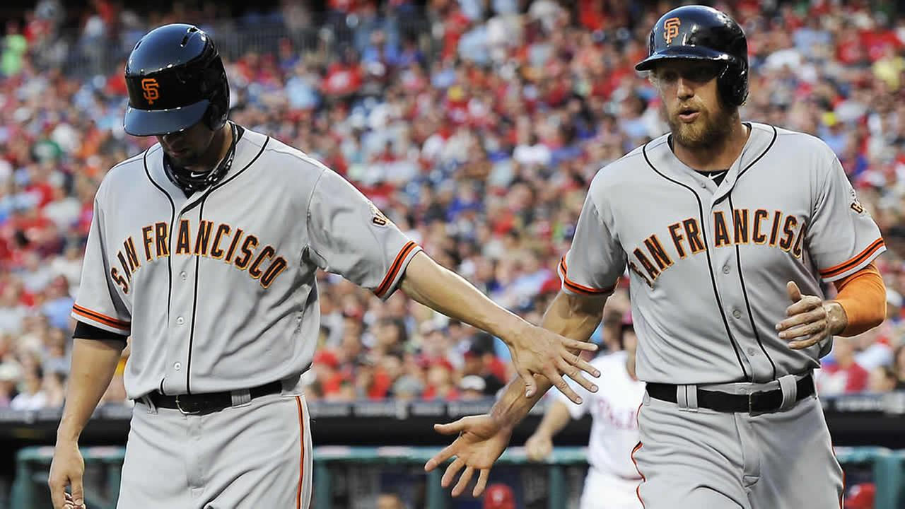 San Francisco Giants Ryan Vogelsong, left, celebrates Hunter Pence after they scored on a Buster Posey single in the third inning of a game on July 21, 2014, in Philadelphia. (AP Photo/Michael Perez)