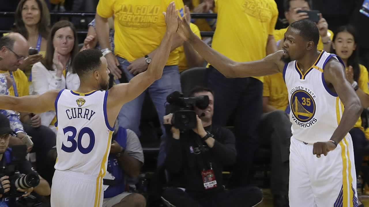 Warriors forward Kevin Durant and guard Stephen Curry celebrate during Game 2 of the NBA Finals against the Cleveland Cavaliers in Oakland, Calif., Sunday, June 4, 2017.