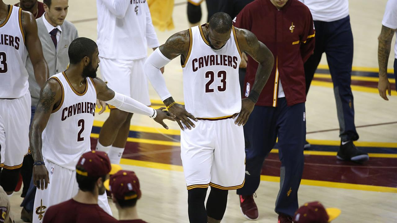 LeBron James and his teammates hang their heads on the court at game three of the NBA Finals in Cleveland, Ohio on Wednesday, June 7, 2017.AP