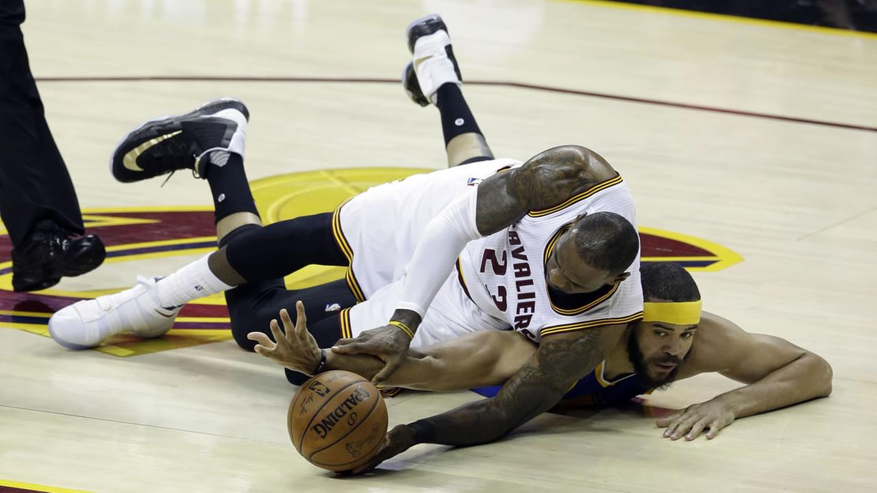 JaVale McGee and LeBron James fight over the ball at game three of the NBA Finals in Cleveland, Ohio on Wednesday, June 7, 2017.AP