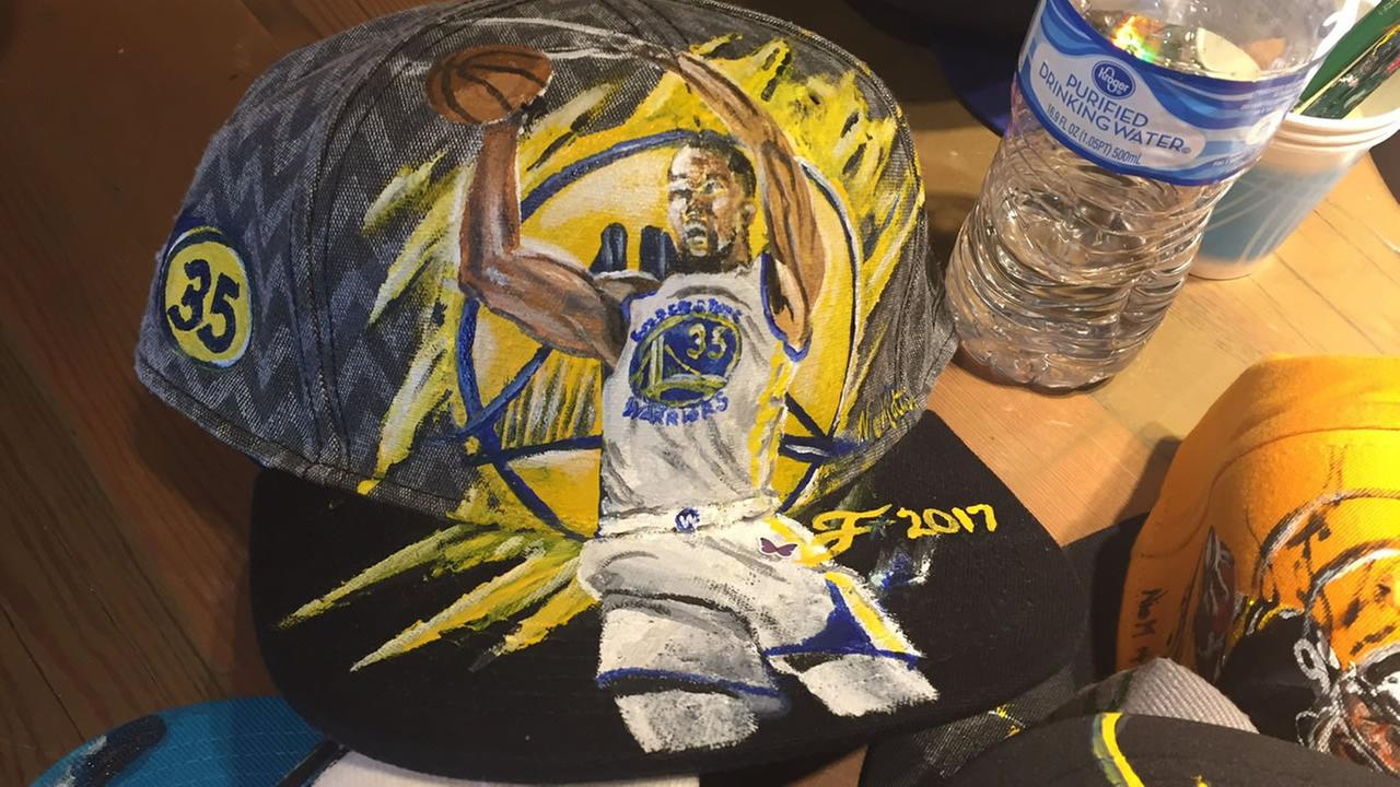 Warriors fan Nick Motleys art of Kevin Durant is seen on a baseball cap on Wednesday, June 6, 2017.