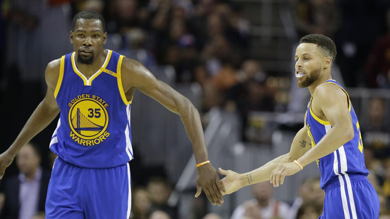Warriors forward Kevin Durant and Stephen Curry play against the Cavaliers during the second half of Game 3 of basketballs NBA Finals in Cleveland, Wednesday, June 7, 2017.