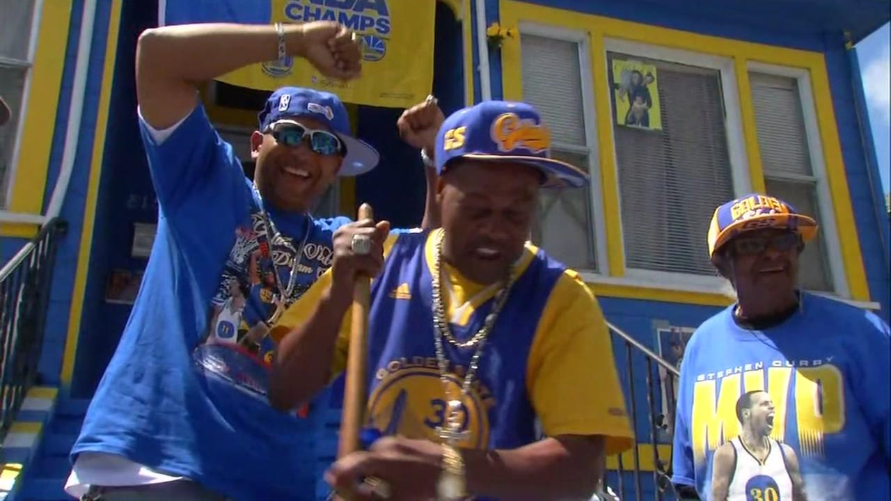 Fans stand in front of a Warriors-ed-out house in Oakland, Calif. on June 9, 2017.