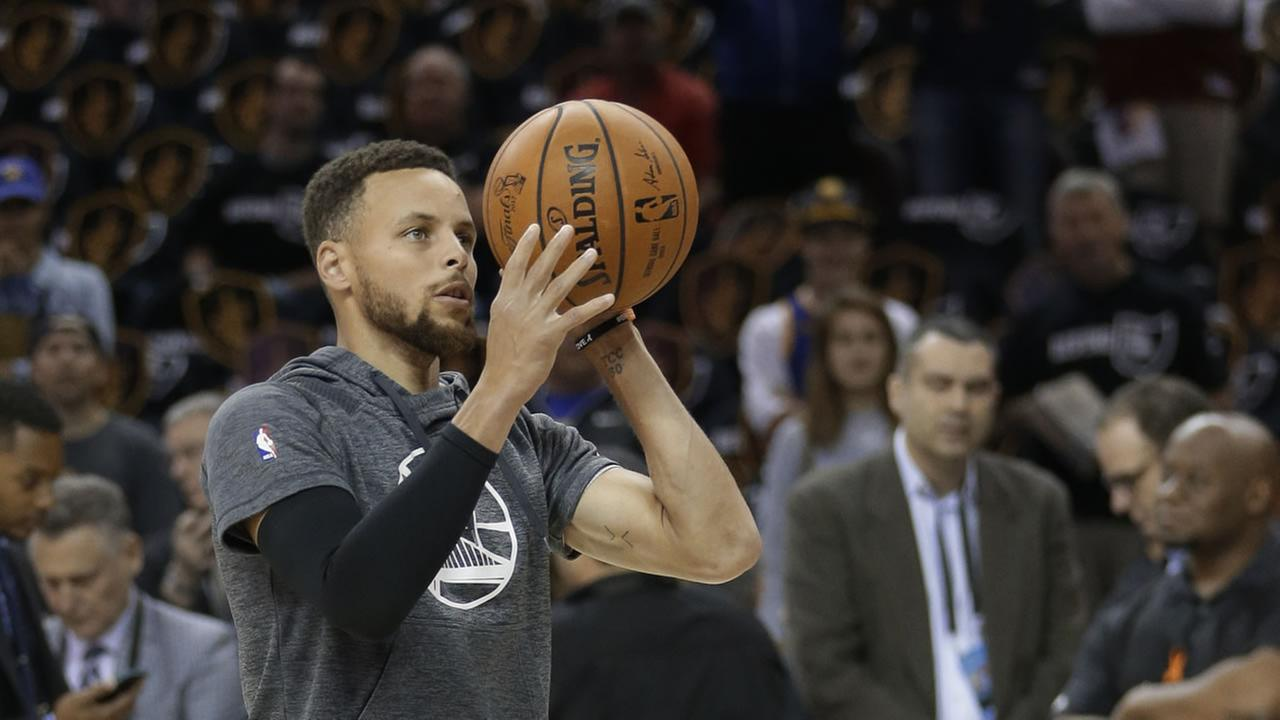 Steph Curry warms up ahead of game 4 of the NBA Finals in Cleveland, Ohio. on June 9, 2017.AP