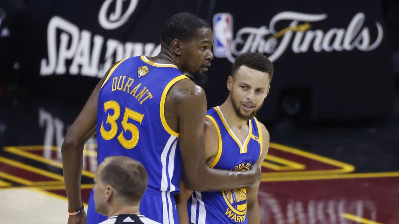 Golden State Warriors forward Kevin Durant (35) holds back Stephen Curry (30) from referee John Goble during Game 4 of the NBA Finals in Cleveland, Ohio on June 9, 2017.AP