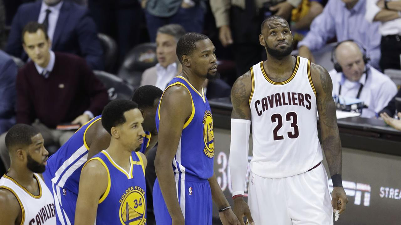 Warriors forward Kevin Durant (35) and Cavaliers forward LeBron James (23) wait for play in the first half of Game 4 of basketballs NBA Finals on June 9, 2017.AP