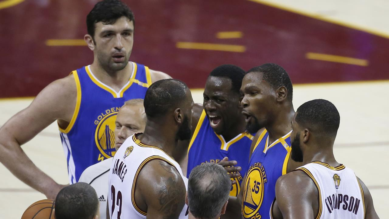 Warriors forward Kevin Durant (35) and Cavaliers forward LeBron James (23) square off on the sidelines of Game 4 of basketballs NBA Finals on June 9, 2017.AP