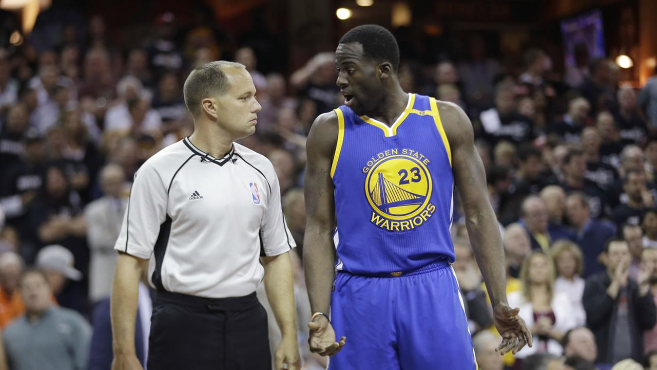 Golden State Warriors forward Draymond Green (23) questions referee John Goble (30) about a foul against the Cleveland Cavaliers during the NBA Finals on June 9, 2017.AP