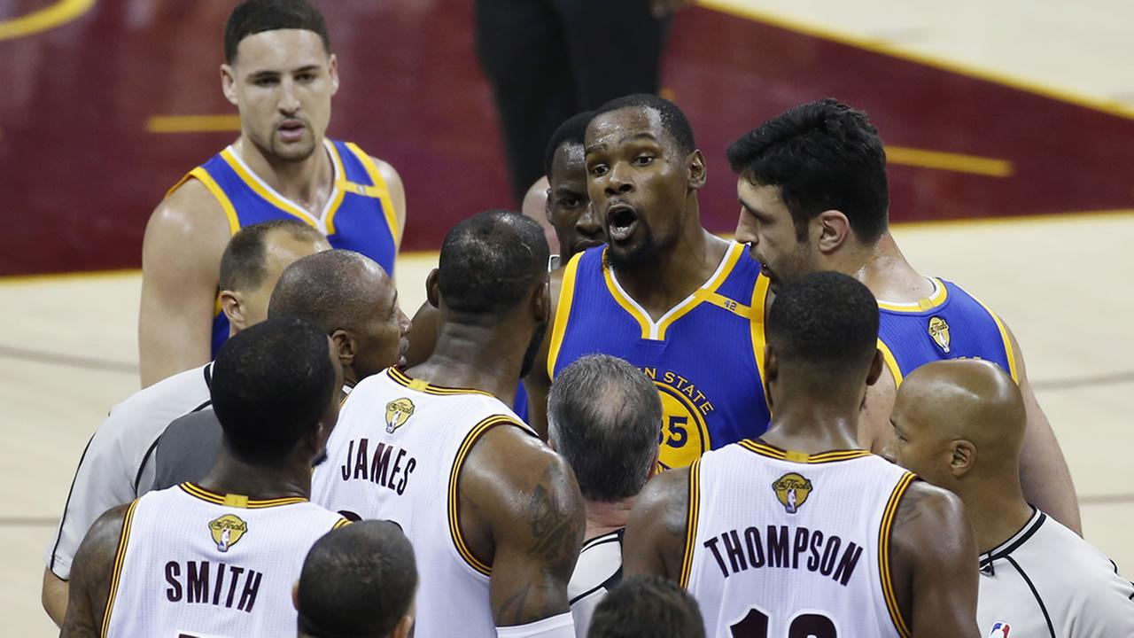 Golden State Warriors forward Kevin Durant (35) argues with Cleveland Cavaliers forward LeBron James (23) in the second half of Game 4 of basketballs NBA Finals in Cleveland, Friday, June 9, 2017. (AP Photo/Ron Schwane)AP Photo/Ron Schwane