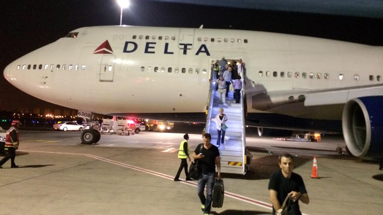 In this photo provided by Michael Simon, a New York-bound Delta Air Lines plane is seen at Ben Gurion Airport in Tel Aviv, Israel, after an emergency Sunday, July 13, 2014.
