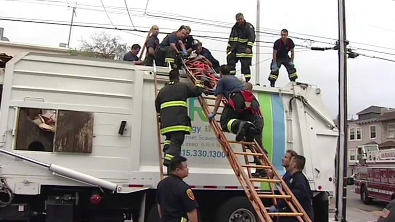 Man rescued from recycling truck in San Francisco.
