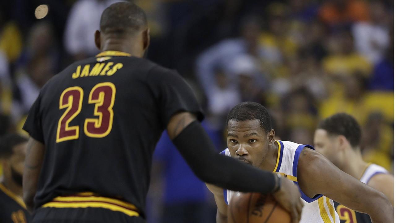 Warriors' Kevin Durant defends Cavaliers' LeBron James during Game 5 of the NBA Finals in Oakland, Calif., Monday, June 12, 2017. (AP Photo/Marcio Jose Sanchez)