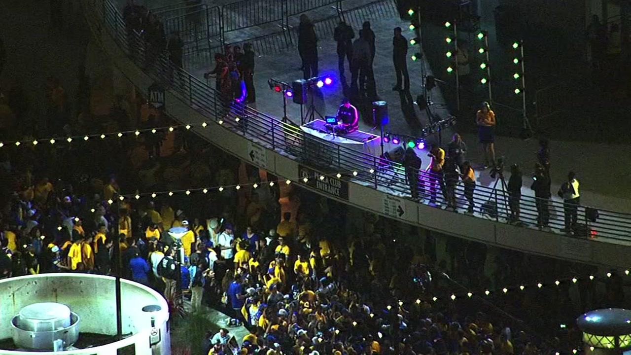 Warriors fans celebrate the team's new NBA title in front of Oracle Arena in Oakland, Calif. on Monday, June 12, 2017.KGO-TV