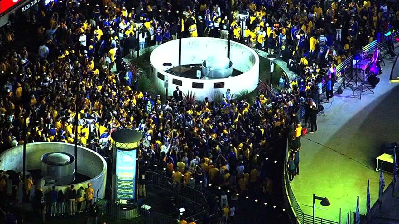 Warriors fans celebrate the team's new NBA title in front of Oracle Arena in Oakland, Calif. on Monday, June 12, 2017.