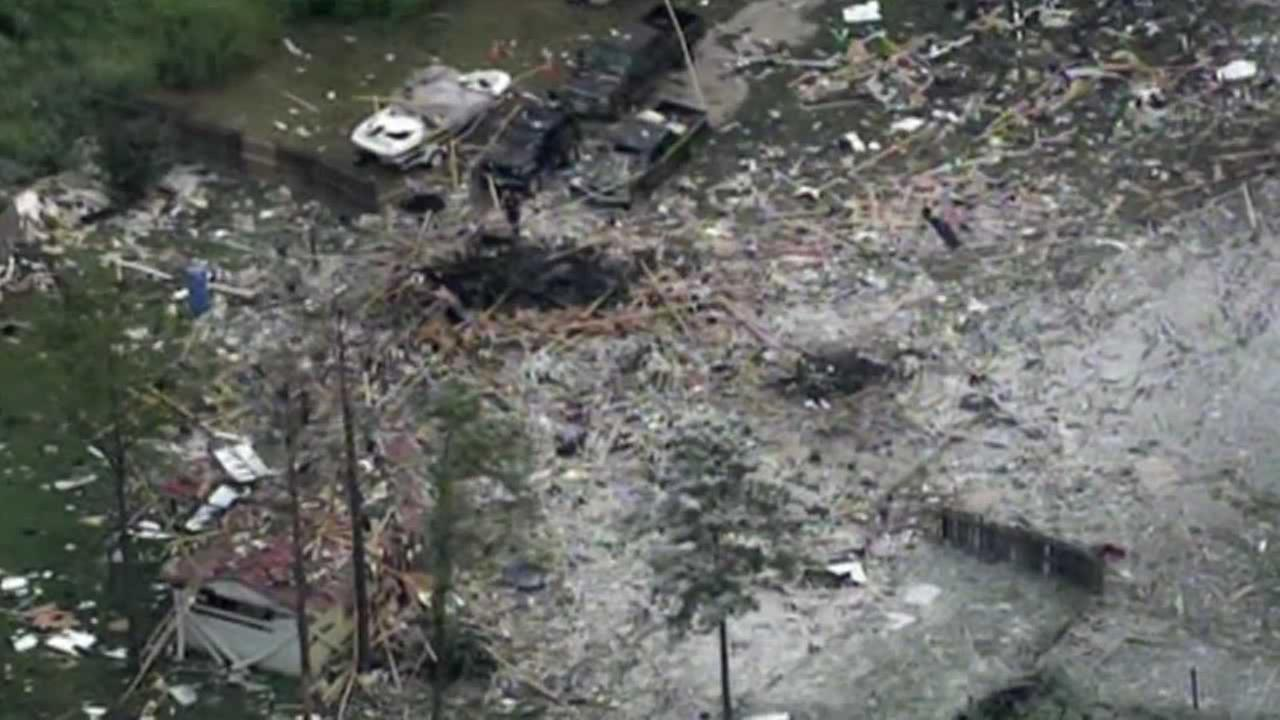 A home near Willis, Texas is leveled in an unknown explosion Tuesday.