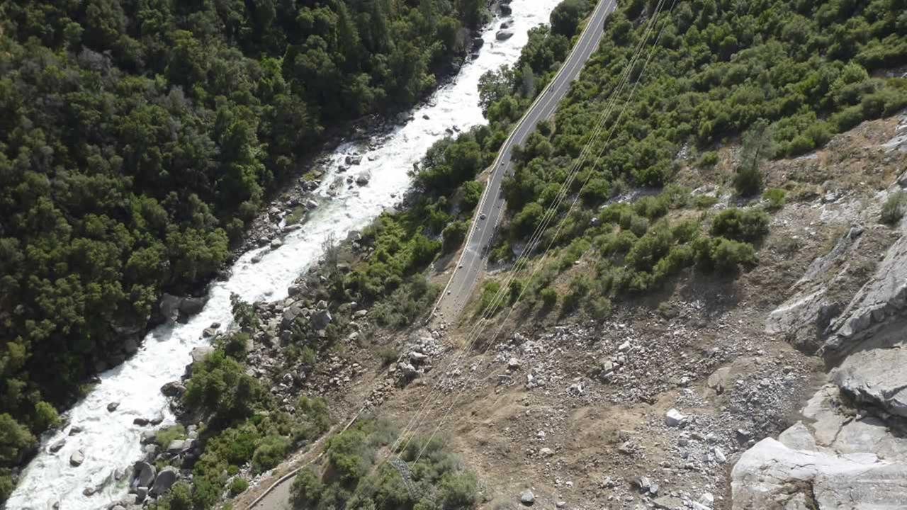 This Monday, June 12, 2017, photo provided by the National Park Service shows a rockslide that blocked one of the main roads into Yosemite National Park in California.