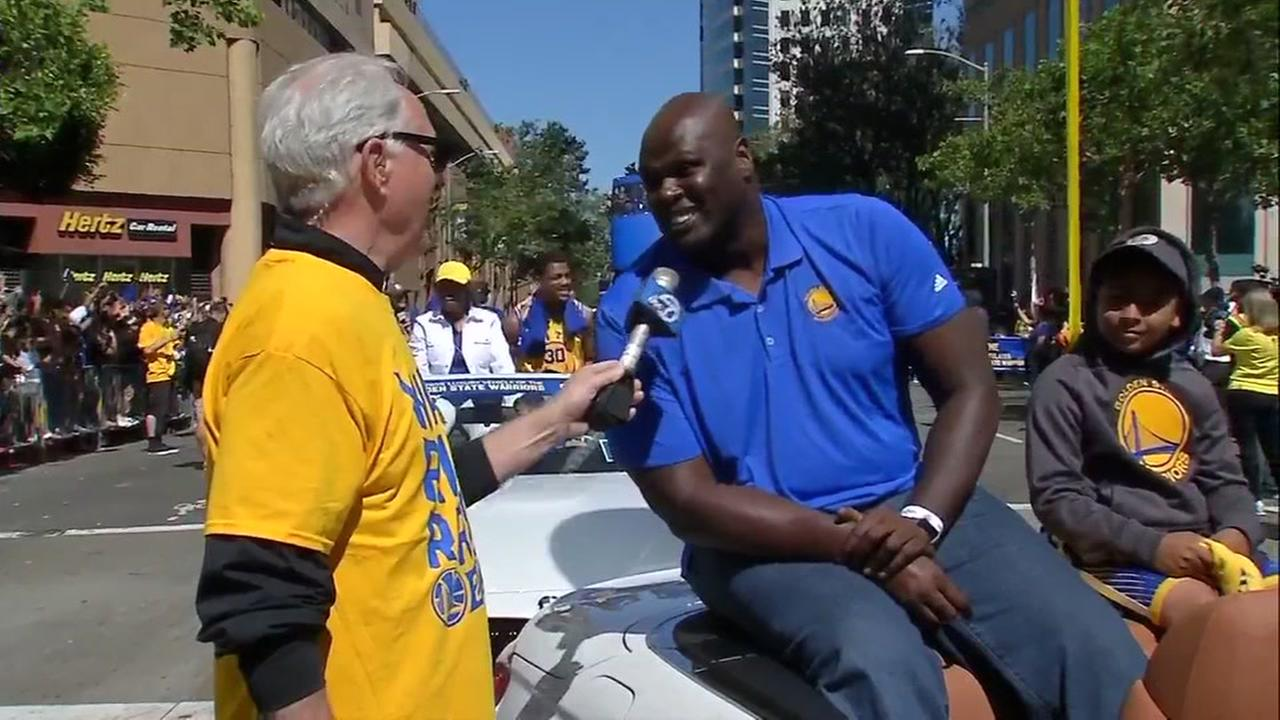 ABC7News Mike Shumann speaks to Adonal Foyle at the Warriors parade in Oakland, Calif. on Thursday, June 15, 2017.KGO-TV