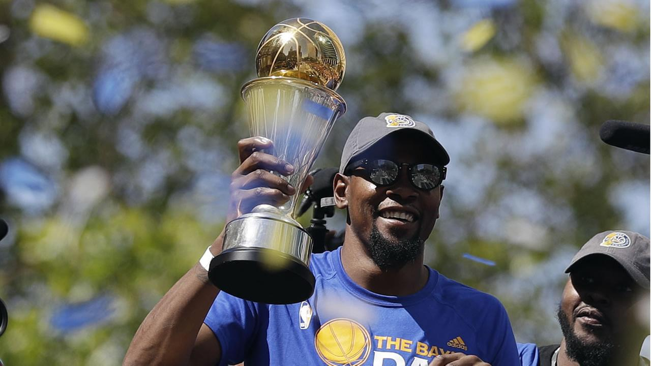 Kevin Durant celebrates the Golden State Warriors NBA Championship during the parade and rally in Oakland, Calif. on June 15, 2017.