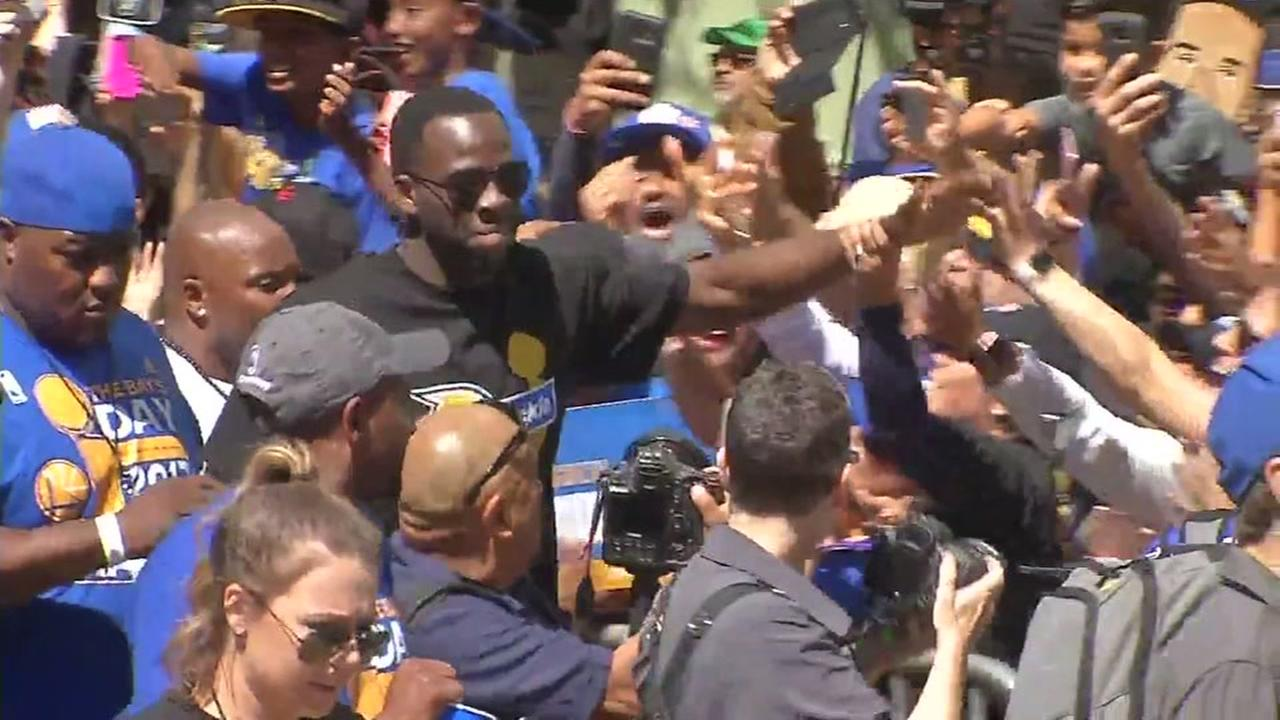 Draymond Green runs through the crowd and congratulates fans during the Warriors championship parade and rally in Oakland, Calif. onThursday June 15, 2017.